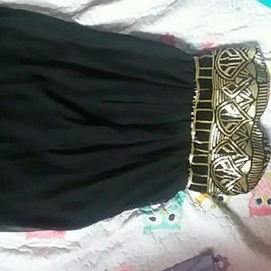 Knee high, black and gold sequin dress
